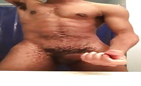 Black male stroking meat in front of mirror