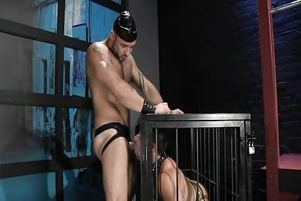 Caged slave serving his master with mouth and booty