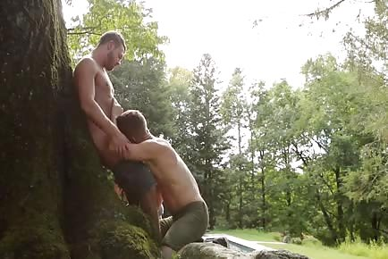 superb guys fucking on a tree in the woods