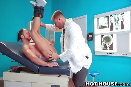 Dr. Austin Wolf examines ass of athletic patient Brendan Phillips