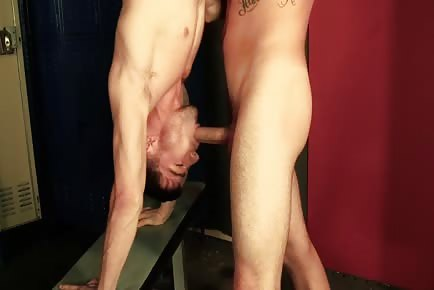 Two acrobatic hunks 69 hand stand in locker room