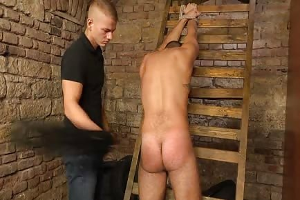 Hunk tied, slapped and tortured in dungeon