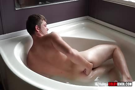 Fingering his butthole in the tub and climaxing on himself