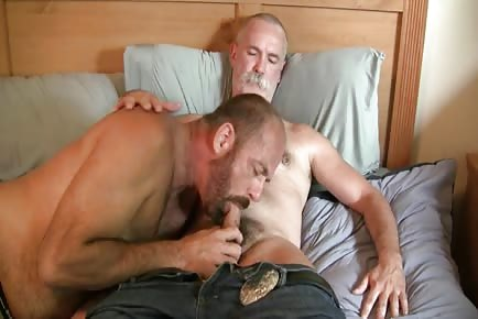 Horny older dog gets dick eaten by other dude