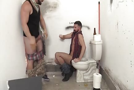 Rednecks urinate on stud and gangbang him bareback in public toilet