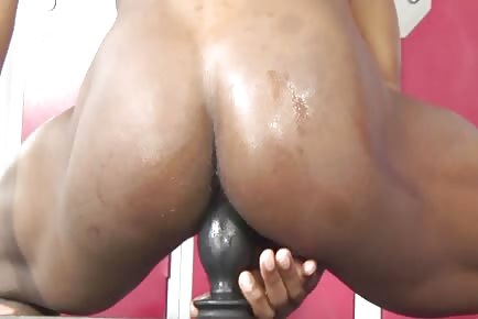 Bubble behind ebony stud sits on fat butt plug