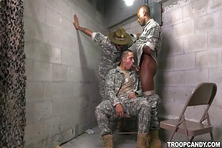Military trooper blowing large ebony cock