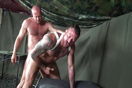 Muscular army grunts fuck raw in military tent